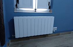 Instalación de calefacción por radiadores de Neytesa. En la foto un radiador instalado