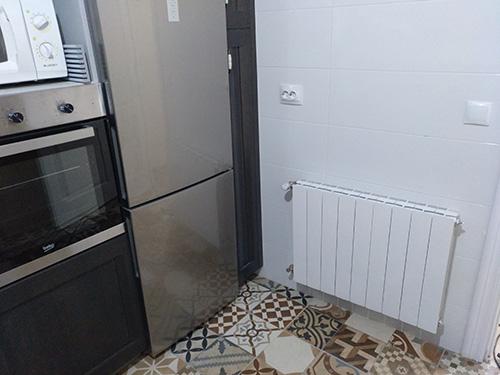Radiador instalado por neytesa en una cocina